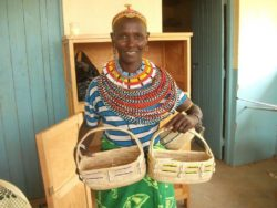 Nkerisaba Holding Her Bread Baskets 250×188