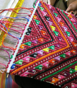 Weavers in Chinantla, Mexico use gorgeous vivid colors. Photo credit Tia Stephanie Tours
