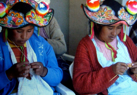 Lake Titicaca, Peru.  Hats are shaped over reeds from Lake Titicaca.
