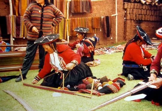 Cusco, Peru.  Women preparing to weave.