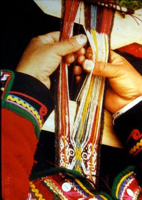 Cusco, Peru.  Woman weaving
