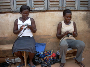 Janet and Mercy practice their crochet skills